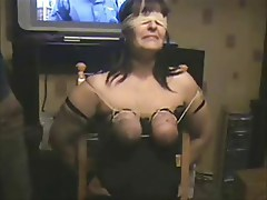 Whipping big boobs of my slut slave. Home made