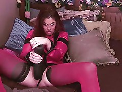 Sexy milf plays with a big dildo and squirts