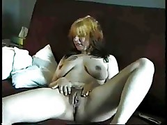 Mature  shows us her titties and pussy