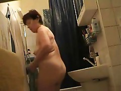 Watch my mum nude after shower. Hidden cam