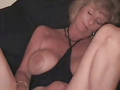Nasty mature slut using a beer bottle to masturbate