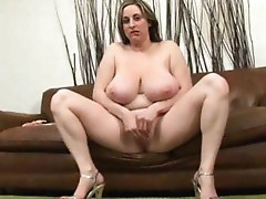Chubby blonde MILF with a pair of big droopy  boobs gets fucked by a black man