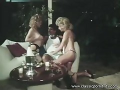 Two curly-haired blondes get it one with legendary cocksman Harry Reems