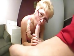 Young cock blown by mature lady on her knees