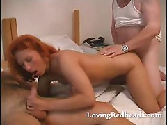 Redhead MILF wild sucking in threesome