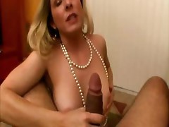 Cougar bimbo is sucking a cock