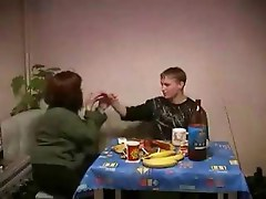 Russian brunette mom has dinner with young neighbor and his cock