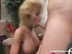 Blonde cougar with nice tits keeps her stockings on as he bangs her