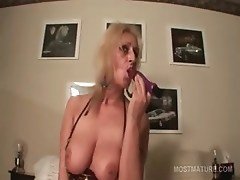 Busty mature blonde fucking her peachy snatch with dildo