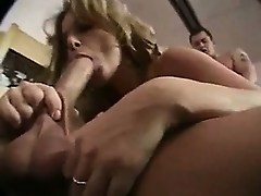 Milf with big tits gets two dicks