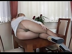 Milf ALA poses in silky pantyhose, heels and thong