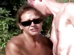 My mature bitch jerking a stranger boy at nude beach