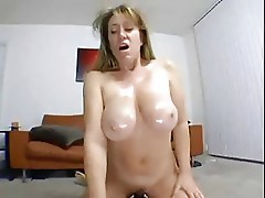 Mature tits in oil