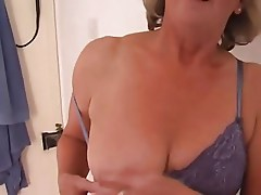 Adorable Granny Fingers her Pierced Pussy
