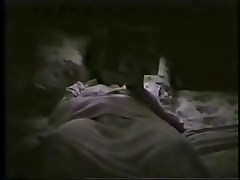 My mom on bed fingering reading a book. Hidden cam