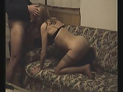 Mature slut in stockings fucks on sofa