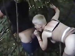 Mature bitch dogging with voyeurs
