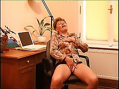 Beautiful mature women masturbates in her office