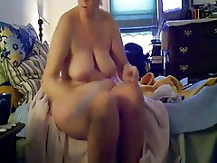 My busty mummy dressinf after shower. Hidden cam