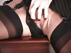 Lady with sillicone boobs use a dildo