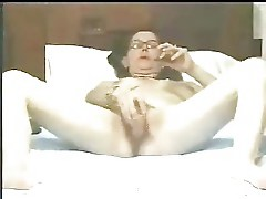 Nasty wife masturbates watching a porno