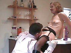 Sexy mature lady on table