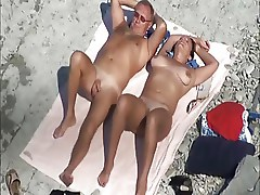 Blow job on nude beach.