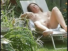 Super ! Must see my cute mum masturbating in the garden