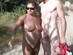 My bitch jerking strangers at nude beach