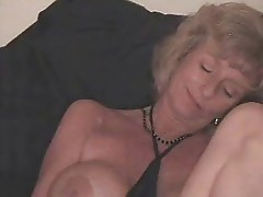 Kinky granny using bottle to masturbate