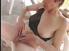 Mature fingering her hairy pussy