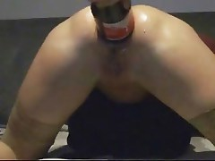 Anal insertion of big coca cola bottle