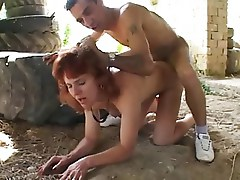 mature redhead with boy outdoors