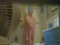 Hidden cam catches my mom nude after shower