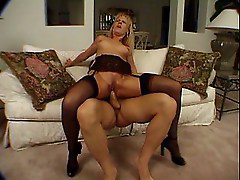 Hot mature blonde riding