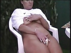 Older lady masturbating outdoor