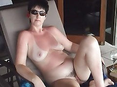 Lynne relaxing sunbathing naked