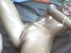 He oils her and fuck in both holes