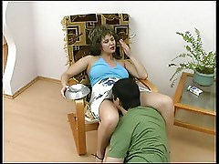 Mature lady seduces young boy